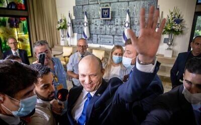 New Israeli Prime Minister Naftali Bennett waves at the President's Residence in Jerusalem on June 14, 2021. Photo: Yonatan Sindel/Flash 90