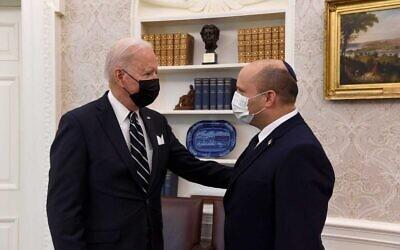 Israeli Prime Minister Naftali Bennett (right) speaks as he meets with US President Joe Biden in the Oval Office of the White House on Friday, August 27. Photo: GPO