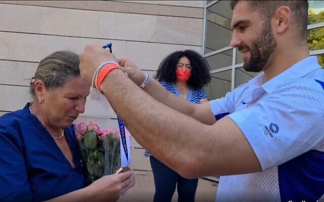 Judoka Peter Paltchick gives the bronze medal to mother Larissa. Photo: Instagram screenshot