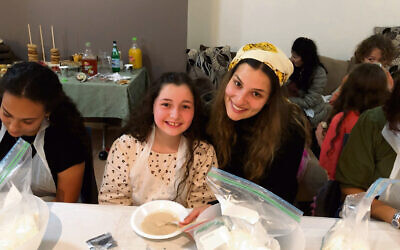 Rebecca Vayn with niece Mindy Brown at a Cairns Chabad House challah bake. Photo: Chabad Cairns