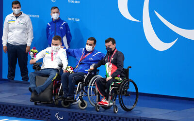 Israel's Iyad Shalabi, centre, with the gold medal after the Men's 100m Backstroke - S1 Final at the Tokyo Aquatics Centre on day one of the  Paralympic Games in Japan. Photo: Getty Images