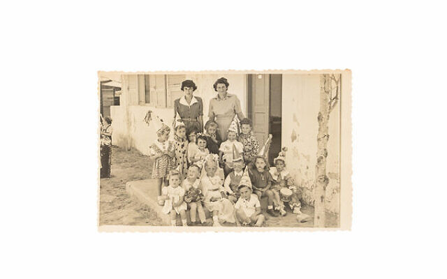 Magda established a kindergarten in Israel. Maya is standing first on the left as the class celebrates the festival of Purim.
