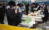 Inspecting the Arba Minim at a Jerusalem market. Photo: Wikipedia