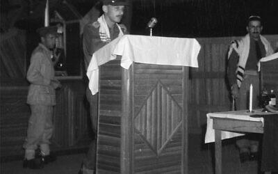Captain John Einfeld (front) and Chaplain Rabbi Lazarus Goldman (right) leading a Jewish New Year service in Lae, New Guinea, in 1944. Photo: Australian War Memorial