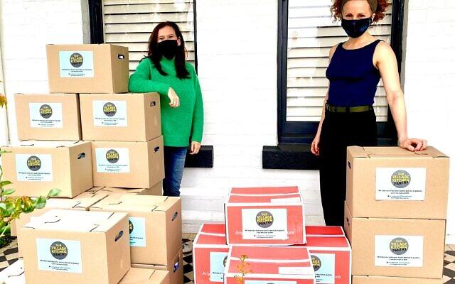 Our Village Kitchen's Lisa Lipshut (left) delivering Rosh Hashanah boxes to Pathways' Leah Bolton.