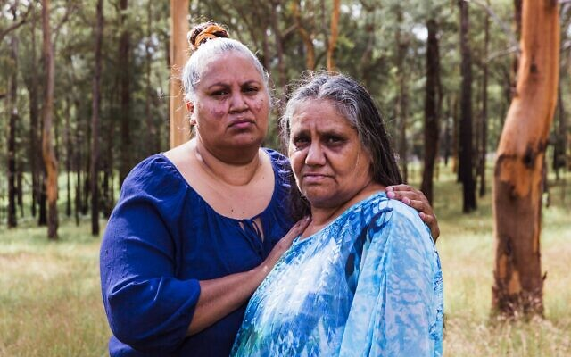 Rebecca Stadhams (right) with her sister Michelle Jarrett in Bowraville. Evelyn was Rebecca's daughter. Photo: Kate Holmes