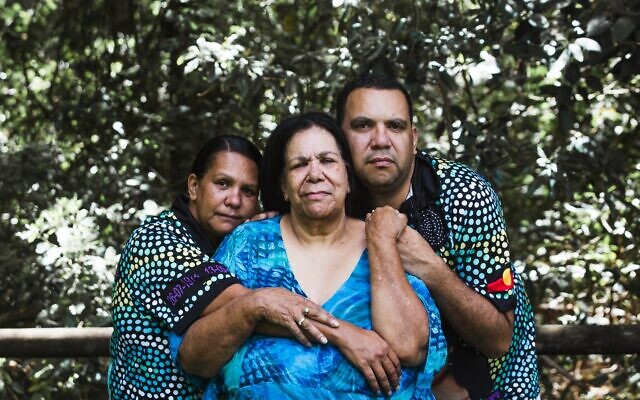 Muriel Craig, the mother of Colleen Walker-Craig (centre), with her daughter Paula Craig (left) and son Lucas Craig (right). Photo: Kate Holmes.