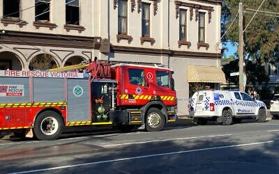 Police and fire crews outside Melbourne Kosher Butchers on Inkerman St on Tuesday morning.