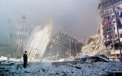 A man stands in the rubble after the collapse of the first World Trade Centre Tower on September 11, 2001.  Photo: AFP Photo/Doug Kanter