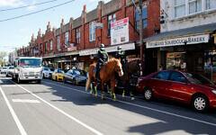 Police on horseback patrolling Glen Eira Rd in Ripponlea on Wednesday afternoon.