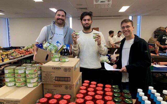 Brent Shapiro, Daniel Sacks, Alan Lewis creating and distributing boxes on Pesach this year.