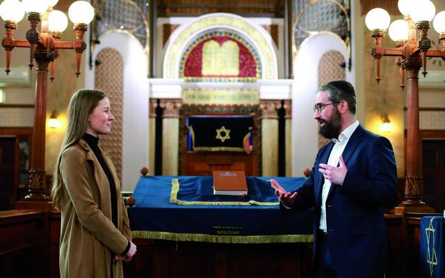 12-8-21. The AJN's Carly Douglas at St Kilda Shule taking with Rabbi Yaakov Glasman. Photo: Peter Haskin