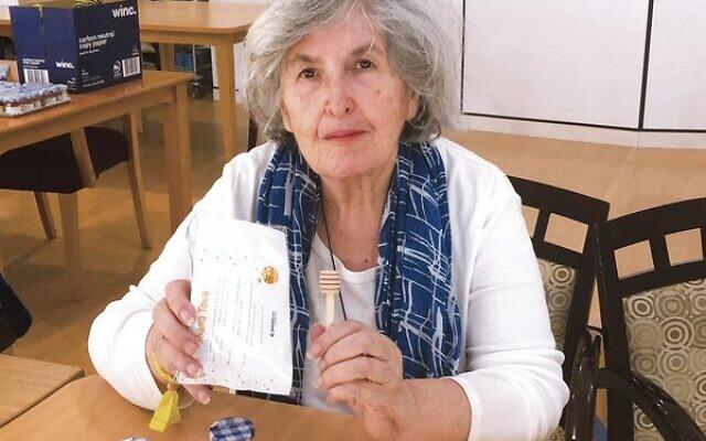 Gary Smorgon House resident Shirley Leivenzon making Rosh Hashanah gift packs.