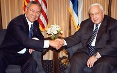 US Secretary of State Colin Powell, left, shakes hands with Israeli Prime Minister-elect Ariel Sharon in Jerusalem on February 25, 2001. Photo: Getty Images
