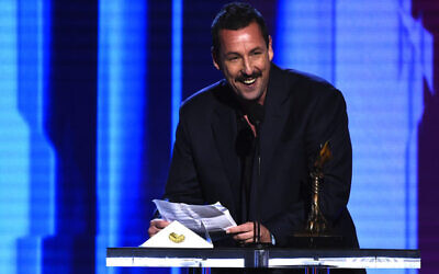 Adam Sandler accepts the award for best male lead for Uncut Gems at the 35th Film Independent Spirit Awards in 2020. Photo: AP Photo/Chris Pizzello