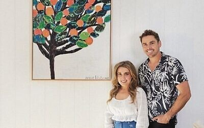 The Block contestants Kirsty and Jesse with their Anna Blatman painting.