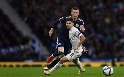 Israel's Manor Solomon (front) eyes the ball in a World Cup qualifying match against Scotland in Glasgow on October 9. Photo: AP Photo/Scott Heppell
