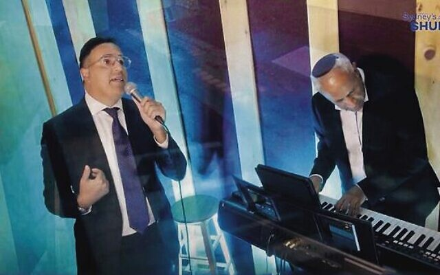 Singer Yaakov Shwekey performs in the online concert.