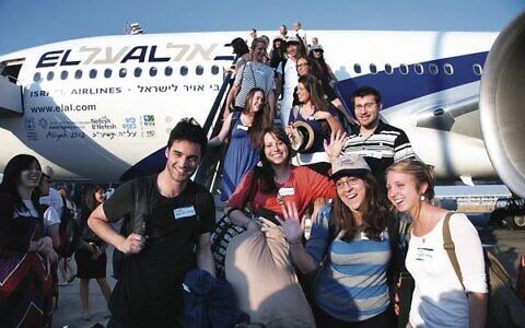 Passengers stepping off an El Al plane at Ben Gurion Airport. Photo: Sason Tiram