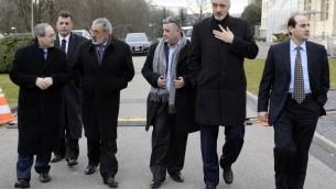 وفد الحكومة السورية في جنيف قبل لقاء مع الصحافة  © اف ب فيليب ديماز