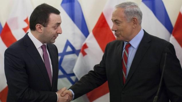 رئيس الوزراء بنيامين نتانياهويصافح رئيس وزراء جيورجيا اراكلي جاريباشفيلي في مؤتمر صحفي مشترك 28 يناير 2014 (فلاش 90)