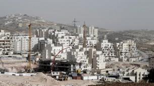 ورشة بناء مساكن في هار حوما بالقدس الشرقية في 20 كانون الاول/ديسمبر 2013  (ا ف ب/ارشيف احمد الغرابلي)© ا ف ب/ارشيف احمد الغرابلي