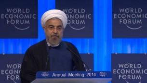 حسن روحاني يلقي خطابه في دافوس 23 يناير 2014  (صورة شاشة اجتماع القمة الاقتصادية في دافوس)