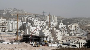 ورشة بناء مساكن في هار حوما بالقدس الشرقية في 20 كانون الاول/ديسمبر 2013  (ا ف ب/ارشيف احمد الغرابلي)