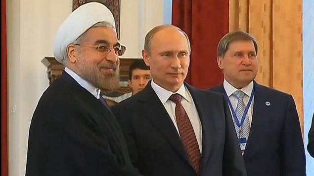 الرئيس الروسي فلاديمير بوتين مع نظيره الايراني حسن روحاني في موسكو 13 سبتمبر 2013 (من شاشة اليوتوب)