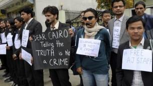 مظاهرة دعم في كوالالامبور نيبال, لصحافيي الجزيرة المعتقلين في مصر 24 مارس 2014 (بعدسة فاركاش ماتيما/ أ ف ب)