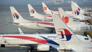 طيارات الخطوط الجوية الماليزية في مطار كوالالامبور 30 مارس 2014 (بعدسة روسلان رحمان/ أ ف ب)