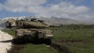 مدفعية اسرائيلية في هضبة الجولان ١٩ مارس ٢٠١٤ (بعدسة جلاء مرعي/ أ ف ب)