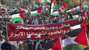 مسيرة يوم الارض في عرابة ٣٠ مارس ٢٠١٤ (احمد غرابلي/أ ف ب)