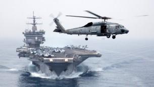 مروحية حربية امريكية امام حاملة الطائرات اليواس اس انتربرايز (photo credit: CC BY Official U.S. Navy Imagery, Flickr)