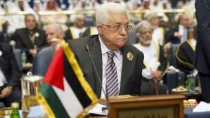 القائد الفلسطيني محمود عباس اثناء القمة الخامسة والعشرون للجامعة العربية 25 مارس 2014 (بعدسة ياسر الزيات/ أ ف ب)