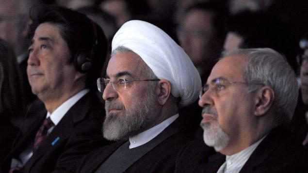 الرئيس الايراني حسن روحاني ووزير خارجيته محمد جواد ظريف في دافوس 22 يناير 2014 (AFP)
