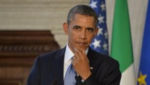 رئيس الولايات المتحدة باراك اوباما في روما ايطاليا ٢٧ مارس ٢٠١٤ (اندرس سولار/ أ ف ب)