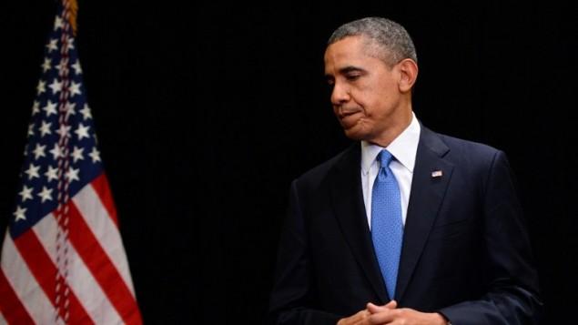 الرئيس باراك اوباما بعد انتهاء حديثه الى الصحافة ٢ ابريل ٢٠١٤ (جول سماد/ أ ف ب)