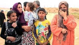 نساء سوريات لاجئات مع اطفالهن (Times of Israel Staff)