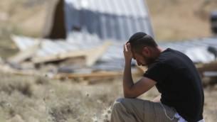 مستوطن  خلال هدم وإخلاء 10 مبنى في بؤرة معاليه رحبعام في الضفة الغربية،  الأربعاء، 14 مايو، 2014، ( ناتي شوحط / فلاش 90)