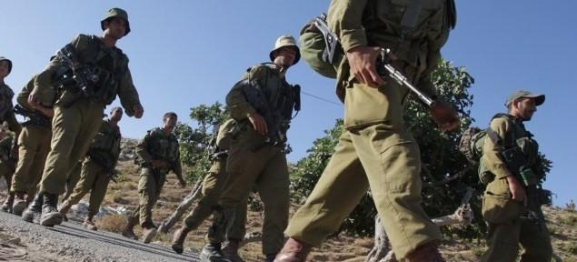 قوات الجيش الإسرائيلي تصل في وقت مبكر من الصباح الى المنطقة الواقعة بين قرية حلحول في الضفة الغربية ومدينة الخليل المجاورة يونيو 24،2014  AFP PHOTO/ HAZEM BADER