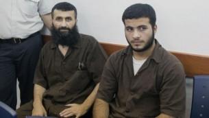 زياد عوض وابنه غز الدين زياد عوض في المحكمة العسكرية بعد اعتقالهما (Yonatan Sindel/Flash90)