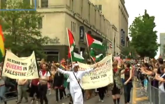 """مثليون ضد الابارتهايد الاسرائيلي"""" في مسيرة تورونتو 2009 (من شاشة اليوتوب)"""