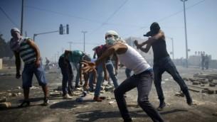 اشتباكات بين فلسطينيين والشرطة في شعفاط Thomas Coex/AFP