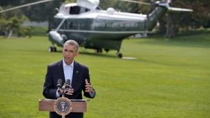 الرئيس الأمريكي باراك أوباما يلقي بيانا  في الحديقة الجنوبية للبيت الابيض 9 أغسطس 2014  تحد أوباما قبل أن يسافر مع أسرته إلى مارثا فينيارد في ماساتشوستس، لقضاء إجازة الصيف. وقال أوباما أنه لا يوجد جدول زمني لعمليات الولايات المتحدة في العراق. AFP PHOTO/Mandel NGAN
