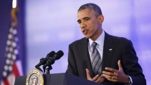 الرئيس الامريكي باراك اوباما امام الصحافة في وزارة الخارجية 6 اغسطس 2014  Alex Wong/Getty Images/AFP