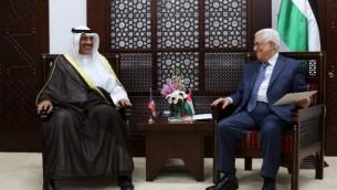 رئيس السلطة الفلسطينية محمود عباس،  ويجتمع مع وزير الخارجية الكويتي الشيخ صباح الخالد الصباح  14 سبتمبر عام 2014 في رام الله   AFP/ABBAS MOMANI