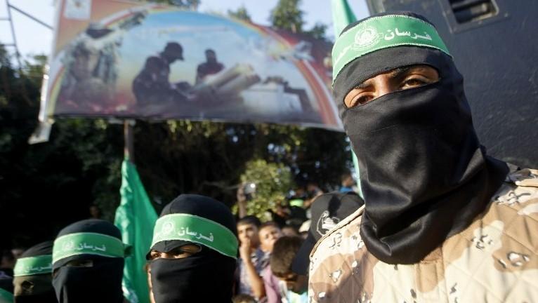 ملثمون في مسيرة تأييد لحركة حماس في رفح، جنوب قطاع غزة. اغسطس 2014    (سعيد خطيب/ أ ف ب)