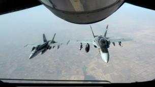 صورة التقطت ب 4 اوكتبر 2014 قدمتها البحرية الامريكية لطائرات  F-18E سوبر هورنيت والتي شنت الغارات ضد الدولة الاسلامية  AFP/ HANDOUT / US AIR FORCE / Staff Sgt. Shawn Nickel