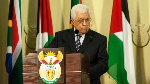 رئيس السلطة الفلسطينية محمود عباس خلال مؤتمر صحفي بعد لقائه مع رئيس جنوب افريقيا 26 نوفمبر 2014  AFP PHOTO/STEFAN HEUNIS
